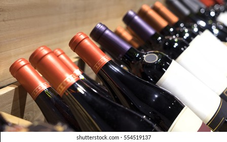 The bottle of wine. wines on display in the chest box. wine shop.