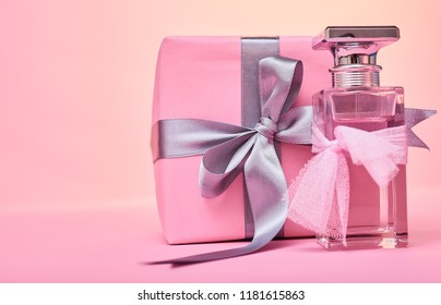 bottle of woman perfume  with pink gift box. gift. packeging of present