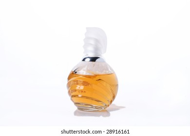 Bottle of yellow perfume. Isolated object on white background