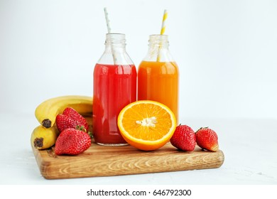Bottled juice and fruit. The concept of beverages, health food and vegetarian