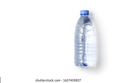 Bottled mineral water isolated on white background. Top view.