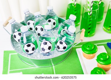 Bottled water in metal tray with ice for football party.