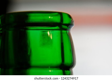 Bottleneck in green color, Empty close-up Bottle, Detox Concept. Abstinence, Alcoholism Treatment. New Year's Resolutions. Becoming A New You, Promising A Better Life.