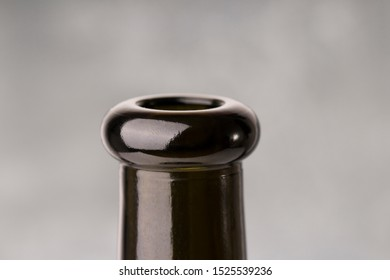 bottleneck of a red wine , close up. gray background