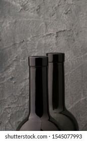 bottlenecks of a red wine , close up. gray background