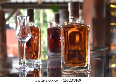 Bottles of alcohol with blurried background, beautiful colors.