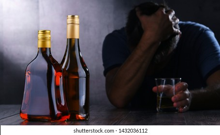 Bottles with alcoholic beverages and the figure of a drunk man