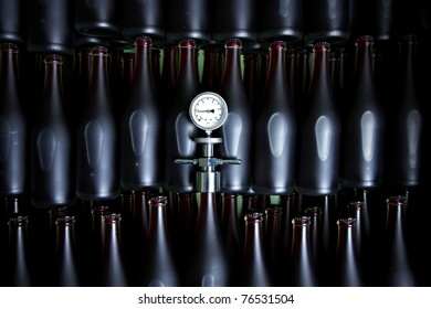 Bottles with Apple Ice Wine and thermometer