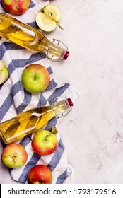 Bottles of Apple Vinegar and Ripe Apples on Light Gray Background Top View Flat Lay Apple Cider