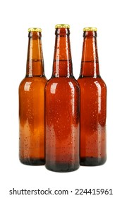 Bottles of beer with drops isolated on white