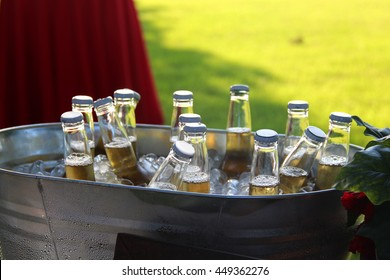Bottles of beer in an ice bucket, ready to drink on a hot summer day