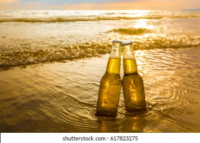Bottles of Beer on the beach at sunset time