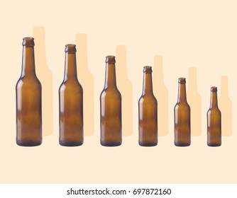 Bottles of beers of all sizes with shadows
