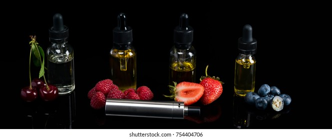 bottles with berry tastes stand on a dark background, liquid for an electronic cigarette, a long photo