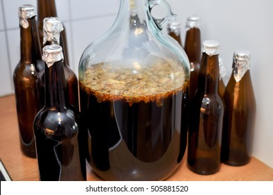 bottles and carboys of home brew beer