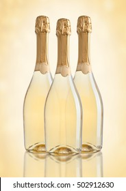 Bottles of champagne golden yellow color on golden background