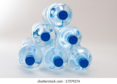 bottles of clear water with blue cap