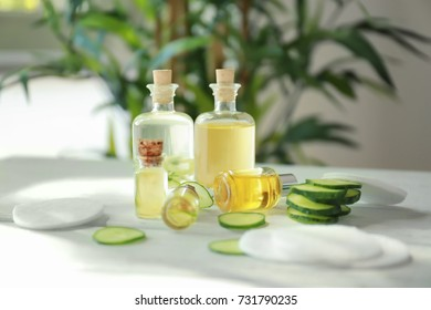 Bottles of cucumber lotion on table