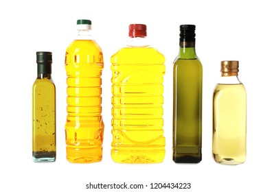 Bottles with different oils on white background