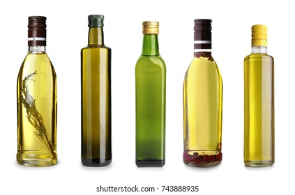 Bottles with different olive oil on white background