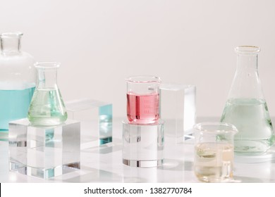 Bottles with different perfume oils on table