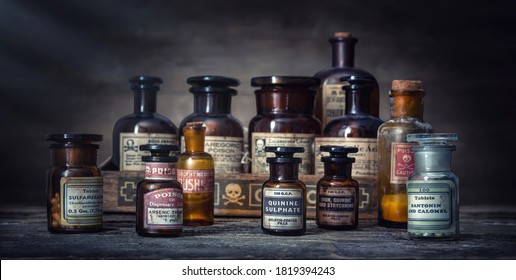 Bottles with drugs from old medical, chemical and pharmaceutical glass. Chemistry and pharmacy history concept background. . Medical  substances- sulfamerazin, arsenic trioxid, quinine sulphate etc.