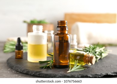 Bottles with essential oils on slate plate