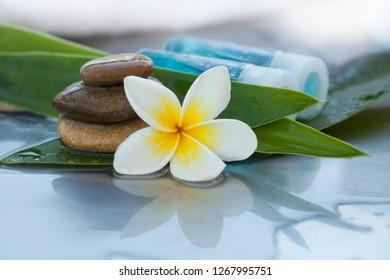 Bottles, flower and stones for massage treatment
