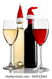 Bottles and glasses of red white wine santa hat on white background