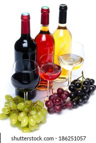 Bottles and glasses of wine with black, red and white grapes, isolated on white