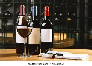 Bottles and glasses with wine on the table. Wine drinking culture concept. Apperetes and survivors. Copy space, dark background - Shutterstock ID 1715008666
