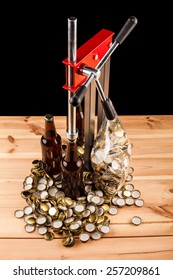 bottles  of homemade beer  and bottle capping machine on table