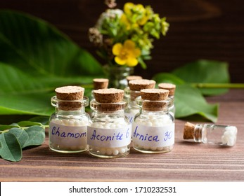 Bottles of homeopathic globules. Homeopathic medicine, jars with homeopathic sugar granules. Naturopathy, aromatherapy, homeopathy - concept