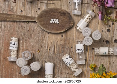 bottles with homeopathy globules and spoon