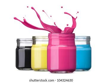 bottles of ink in cmyk colors, magenta with splash