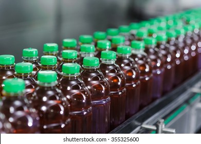 bottles of juice on production line