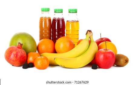 bottles of juice  with ripe fruits on white background