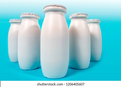 bottles of liquid yogurt isolated on a white background.