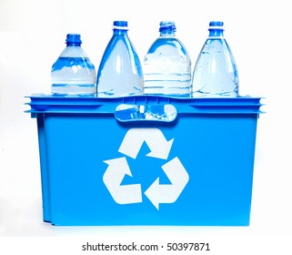 bottles of mineral water  inside recycle bin against white background
