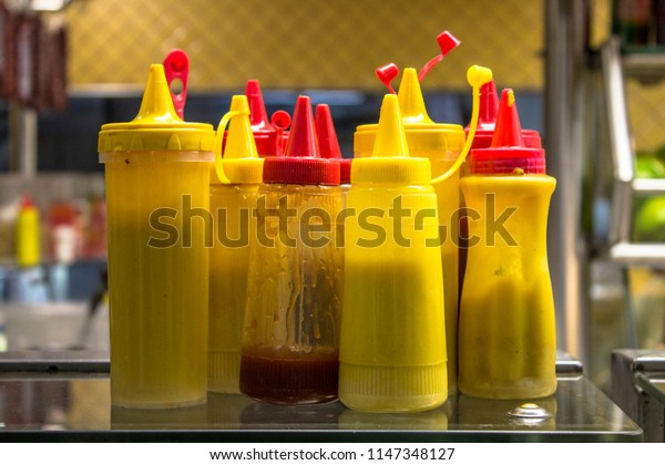 Bottles with mustard, ketchup, and mayonnaise in a bar in downtown Sao Paulo