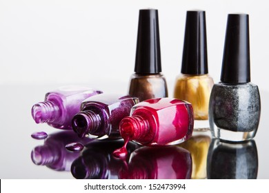 Bottles with nail polish over white
