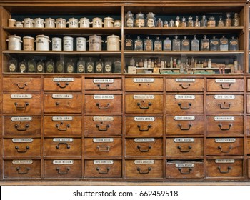 Bottles on the shelf in old pharmacy. Vintage medical background.