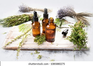 Bottles with organic essential aroma oil for aromatherapy