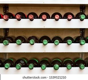 bottles of red wine on the shelf
