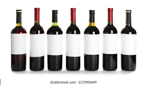 Bottles with red wine on white background