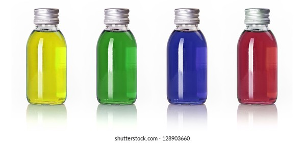 Bottles in a row with different colored liquid isolated over white background