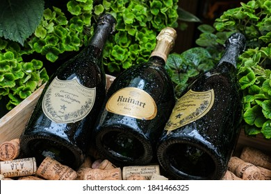 Bottles Ruinart and Dom Perignon with water drops, close-up. Moscow, Russia - October 2020.