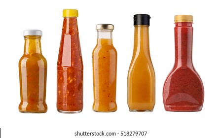bottles of salad sauce with carrots and paprika.