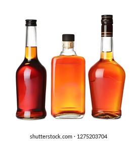 Bottles of scotch whiskey on white background
