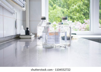bottles with solutions on the medical table